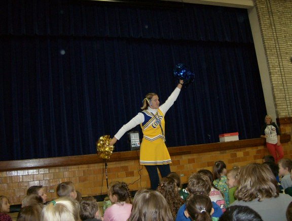 Darien Elementary School Principal Nancy Resch leads a school-wide cheer about making good choices and being drug free!