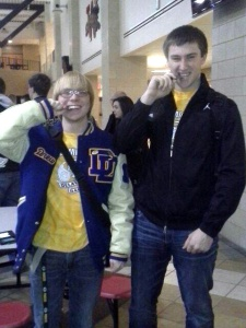 PHOTO CAPTION: In true Olympic spirit, DDHS Academic Bowl winners Drew Pierson (left, chemistry) and John Damrow (right, advanced math) take a bite of their medals after the awards ceremony.  Click to enlarge photo.