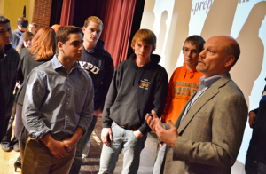 Mike Reader, president of Precision Plus, talks with students at the second annual Manufacturing Career Panel.