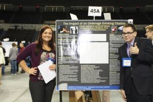 Daniel Gissing (right) and his research partner xxxxx show their research poster at the National Conference on Undergraduate Research. Click to enlarge.