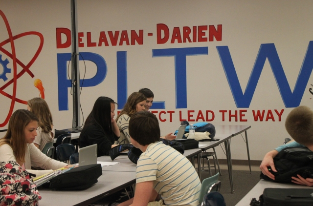 DDHS students work in the PLTW Lab. The room has a computer lab, lecture space and workbenches for creating projects.