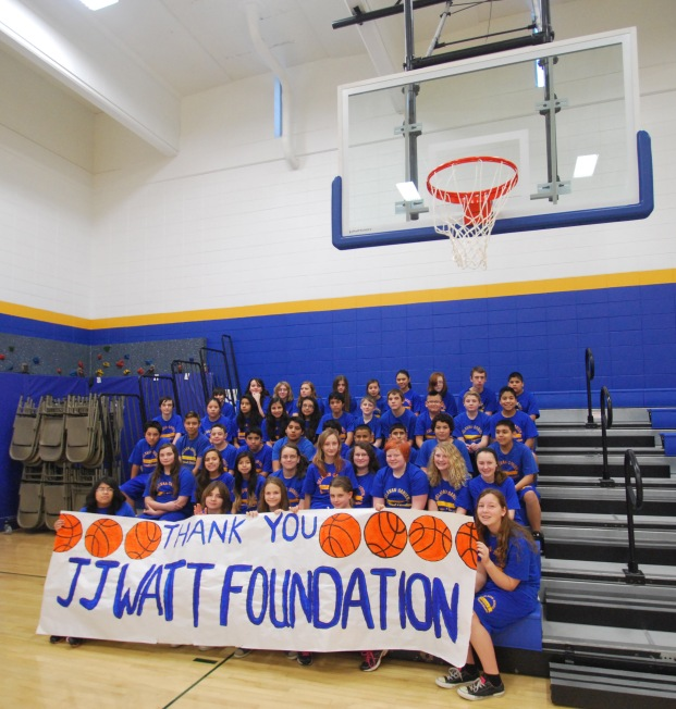 Phoenix students show their appreciation to the JJ Watt Foundation for the school's new basketball hoops.