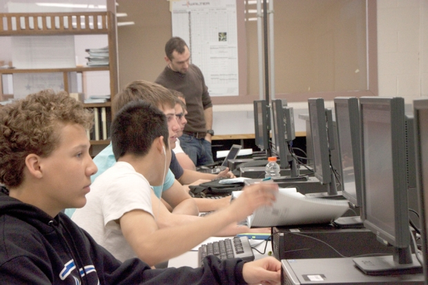 Students design 3-dimensional parts in the technical education computer lab.