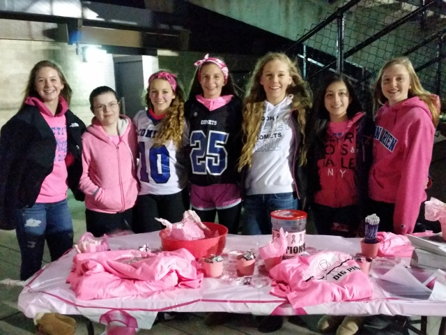 Comet volleyball players sell pink wristbands and t-shirts to create awareness for breast cancer.