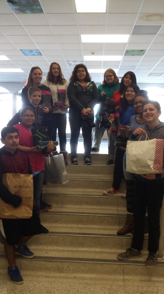 Phoenix Student Council members hold the bags of boots that were bought for Delavan-Darien elementary students in need.
